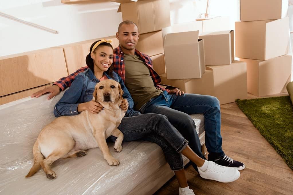 African american couple labrador dog